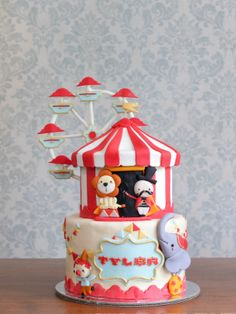 First carnival cake I've done! It was an absolute challenge to make the ferris wheel stand, but was so worth it!!! <3