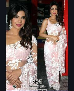 Priyanka Chopra Soft pink sari with white sequins   1. Soft pink net sari 2. White sequins embellished all over in floral patterns 3. Comes with a matching unstitched blouse