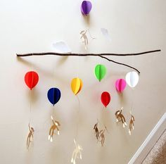 Cute little monkeys hanging from colorful balloons, as clouds drift by. Mobile is made from heavy cardstock. Mobile measures 28 wide by 34