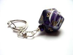 D20 dice keychain purple dice accessory rpg dnd polyhedral dice key ring. $15.00, via Etsy.