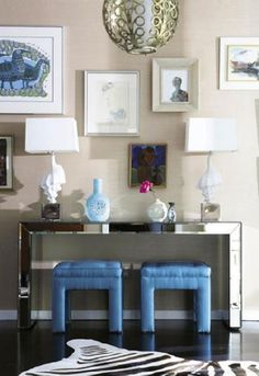 love love the mirrored console table with the blue benches! what a great shade of blue!