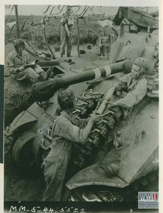 US Sherman tank crew mobilizes for Anzio Break-out, May 1944.