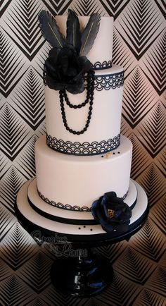 Gatsby themed birthday cake for a 1920s themed 30th birthday party.  All decorations are made from rice paper