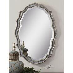 Features:  -Traditional style.  -Oval shape.  Shape: -Oval.  Style: -Traditional.  Wall Mounting Hardware: -Yes.  Beveled Glass: -Yes.  Mirror Type: -Accent.  Orientation: -Both. Dimensions:  Overall