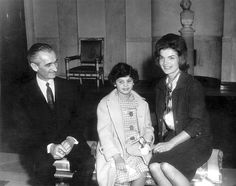 """February 21, 1962 - First Lady Jacqueline Kennedy sits with eleven-year-old Chrysanthemis """"Memi"""" Papacotsis and her father, Spiridon Papacotsis, in the Entrance Hall, White House, Washington, D.C. Memi Papacotsis visited Washington for her heart surgery at Walter Reed Army Hospital, which Mrs. Kennedy helped to arrange. (Photo: Abbie Rowe/JFK Library & Museum)"""