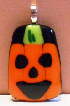 Fused glass Jack-O-Lantern pendant for Halloween (like the way 3 strips actually form the pumpkin)!