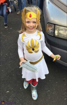 This is my daughter Violet wearing her She-Ra Princess of Power costume I made for her. She got the idea when she ran across some of her daddy's He-Man books. Since she loves superheroes and princesses, She-Ra was a given. I made this by cutting. Family Themed Halloween Costumes, Halloween Costume Contest, Halloween Kids, Halloween 2019, She Ra Costume, Costume Works, Toddler Costumes, Cute Costumes, She Ra Princess Of Power