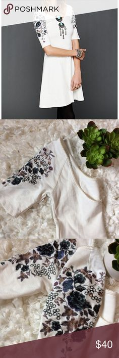 Free People Garden Sleeve Embroidered dress xs Gorgeous off white skater/fit flare style dress. Embroidered sleeves. Scoops on back. Nice thicker material so it's not see through. Will add measurements later today. Free People Dresses Mini