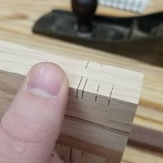 Good morning everybody. I'm making a box today out of that curly hickory from yesterday. Experimenting with tiny handsaw spines first though. Thin kerf Japanese saw for the cut and a really heavy plane shaving for the spline. More decoration than strength. Thumb for scale. #wooworking