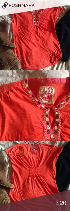 🆕embroidered free people tee w/keyhole detail Cute top from Free People with gorgeous embroidery and keyhole detail at the neck. Reddish orange color, rounded hem and raw edged sleeves. Gathered elastic in the back is a cute detail and adds stretch. Good used condition, with one small hole in the front (as seen in 4th pic). Size large, but seems to run small. Ask for measurements if needed! Free People Tops Tees - Short Sleeve