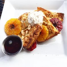 Citrus-bruleed French toast topped with toasted almond slivers and ...