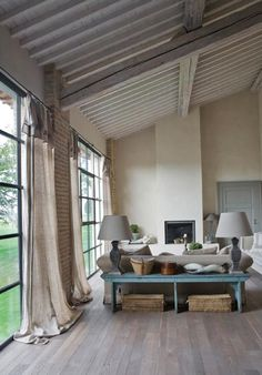 GREAT ROOM-- Simple window treatments, low contrast palette.  Do not like the fireplace but I still dont know what I do want.  Also, LOVE the windows/doors.