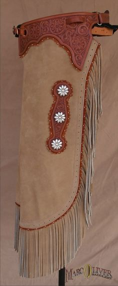 Smokey Ridge Chinks This elegant pair of custom chaps features all the finest details that make my chinks famous, hand set spotwork, hand tooled belt, custom blossom conchos and my custom fit.