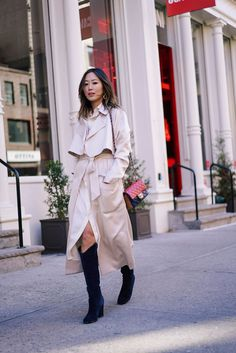 Aimee Song from Song of Style wears a Ralph Lauren shirtdress with a Tibi coat for the Ralph Lauren show during NYFW AW16.