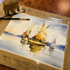 Beautiful #nautical #watercolor #illustration by Instagram artist @amis_trk of #sailboats #mooring in a #harbor with a few #ripples to hint at the fact that the #boats are actually #floating on crisp clear #water. Otherwise I think that this is #painted so well you might not be able to tell the #reflection from the  #boat!  Love the golden color of the #ship in the front and the #sky has a beautiful #gradient that fades from white into ana almost #indigo dark blue.  I'd like to draw your…