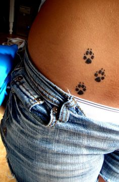 Hip tattoo. With the paws of my lil pup that died.