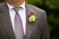 Groom Boutonniere. Calla Lily and Green Orchid. Photo by Claire McAdams Photography.