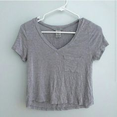 Gray crop top pocket tee vneck Has small fuzzies throughout from wear, but not noticeable in my opinion Charlotte Russe Tops Crop Tops