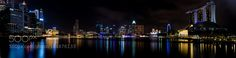 Singapore at night Taken from the Promontory at Marina Bay looking back at Marina Bay Sands the Art & Science Museum Singapore Flyer and hotels and offices Taken at night stitched together from 5 long exposures in Lightroom Loved the lights of the city and their reflection on the bay via 500px ift.tt/1Luw8qw