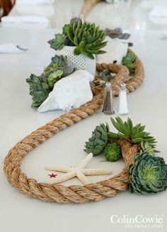Love this funky up cycling idea for an amazing beach table decoration. Mixed with foliage and shells this is the perfect finishing touch to a romantic beach wedding reception. Nautical Centerpiece, Diy Centerpieces, Centerpiece Flowers, Nautical Wedding Decor, Nautical Decor Party, Nautical Rope, Decor Wedding, Table Nautique, Table Arrangements