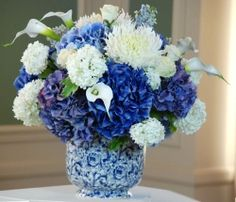 I Really Like How This Vase Adds More To White And Blue Flower Arrangement
