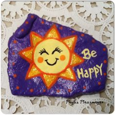 A Happy Sun - Painted rock by Phyllis Plassmeyer