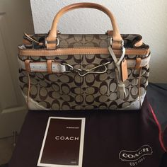 Like new AUTH. COACH HANDBAG Beautiful coach handbag. Like new very little to none wear and tear on the bag. Has a little stain inside the bag as shown in the pictures. Comes with dust bag Coach Bags Totes