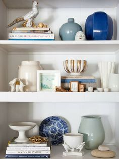 Choose one color. I love the simplicity of this bookshelf!  With the majority of the items in white, blue acts as the accent color in various shades. What a beautiful way to display accessories or collectibles!