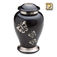 A metal cremation urn with inlaid mother of pearl butterfly design. Stardust Memorials has many nature and butterfly themed cremation urns for ashes.