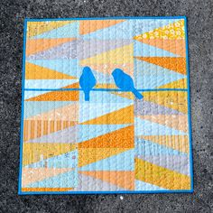 Birds on a wire quilt by AdrianneNZ, via Flickr  Just the triangles ...skip the birds and the  wire