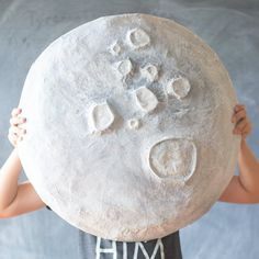 Cardboard, plastic grocery bags, and masking tape are all you need to get started on your own giant paper mache moon!
