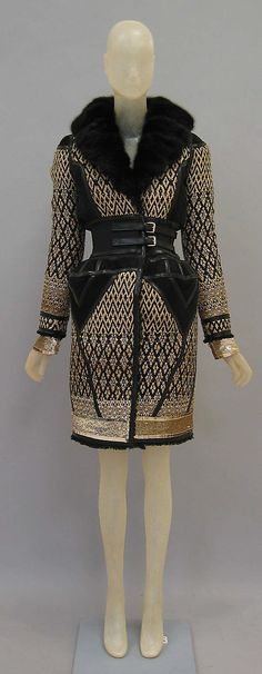 Coat.  House of Balenciaga (French, founded 1937).  Designer: Nicolas Ghesquière (French, born 1971). Date: fall/winter 2007–8. Culture: French. Medium: leather, mink, cotton/synthetic. Dimensions: Length at CB: 42 1/2 in. (108 cm).