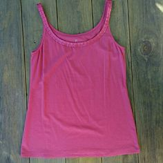 NY&C Pink Ribbon and Rhinestone Tank Top Cami This tank is 56% Cotton, 37% Rayon, and 7% Spandex. I have washed this tank and it has been kept folded in a drawer but I have not worn it, so it's NWOT. The ribbon detailing circles the entire neckline, and there are rhinestones on the ribbon in the front of the tank. (Ribbon only in the back.) It is about 24 inches from the top of the shoulder strap to the bottom of the shirt, and about 15.5 inches from armpit to armpit laying flat. It is a…