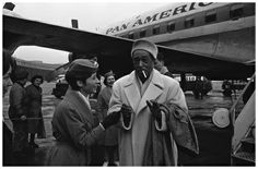 Duke Ellington arriving at Tempelhof airfield, West Berlin, on the 15th Feb 1963. Duke is playing the Berlin Deutschlandhalle. A stewardess tries to stop Duke smoking on the runway... AP Photo/Reichert