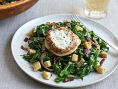Get Bacon-Wilted Greens with Warm Pecan-Crusted Goat Cheese Recipe from Food Network.  Skip or reduce apples to keep carbs lower and fully encrust cheese in pecans to boost fat.