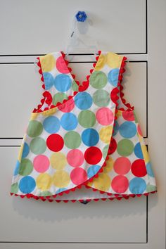 Aesthetic Nest: Sewing: Birthday Dresses for Audrey & KateThis polka dot fabric was the inspiration for Audrey& birthday party. I think it looks so happy. I bought it t.adorable summer top for aBridget Andersons Floral Jackson ByI made Kelly lots of Sewing Kids Clothes, Sewing For Kids, Baby Sewing, Sewing Diy, Cute Little Girl Dresses, Dresses Kids Girl, Kids Outfits, Baby Frocks Designs, Baby Dress Design