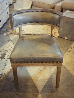 Love this chair.  Sat it in Saturday and it is very comfortable. Carter Leather/Nailhead Chair by celadonhome, via Flickr