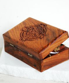 Wood Celtic Cross Carved Jewelry Box Ring Bearer Alternative Pillow. $19.50, via Etsy.