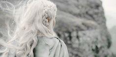 Hair white as sea foam, his dark as crows' feathers.