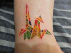 Cute coloured origami bird tattoo