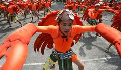 Colourful performers take part in the Aliwan Festival