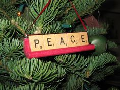 """Scrabble Tile Ornaments. Best Xmas gift ornament that was fun for everyone to make. Ended up making more """"pews"""" for more words.  Made one with last names too."""