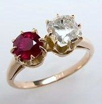 CLAW SETTING: Claw-Set Ruby & Diamond Twin Engagement Ring. Both of the stones featured in this Victorian Era (1837-1910) ring are held in place by eight 14k-gold prongs in a traditional claw setting. Click to read more about claw settings.