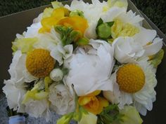 The bridal bouquet: dahlias, freesia, peonies, spray roses, craspedia (billy buttons).