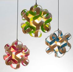 Curls Of Wood With Pops Of Color Surround These Lights