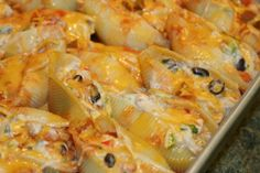 Mexican Chicken Stuffed Shells - new idea for weeknight dinner via Busy at Home (a Secret Recipe Club Recipe) Hearty, delicious chicken and pasta dish with a little southwest or Mexican kick. These are filling and comfort food at it's best! Make them for company and you'll be the hit of the party! Perfect for a Holiday Pot Luck or Buffet