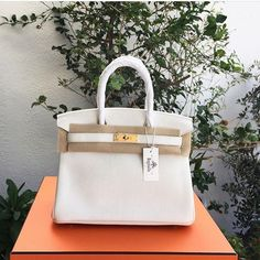 OMG hold your breath and blink twice as what you will see on the photo looks like an early Xmas Fairytale ❄️😀 Hermes White Clemence Birkin 30 GHW stamp X (y 2016 )  Condition: new , box , dust bag  included +971508858360 serious enquirers only please The price is very very reasonable!  #bagatelleboutique #hermes #bagatellehermes #birkin30 #birkins #birkinbags #kelly #rare #musthave #classic #prelovedluxury  #onlineshopping #preowned #bags #ootd #bags  #fashion #ootn #mydubai #authentic…
