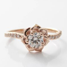 This captivating rose gold diamond ring makes an amazing gift for the woman in your life. It features a 14K rose gold diamond encrusted band with an intricately designed 14K rose gold flower with 0.40ct. diamond center. This lovely ring is the perfect balance of style and grace. It