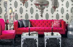 A pop of color on a funky sofa in a grayscale room - way too cool.  Love the Moroccan lamps too!