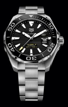 The @tagheuer Aquaracer 300M for men - the stainless steel case measures 43 mm in diameter and holds TAG Heuer's automatic Caliber 5; its indices and hands are enhanced with green and blue Super-LumiNova, it is water-resistant to 300 meters and is shown here with a black dial and bezel on a three-row stainless steel bracelet.  More @ http://www.watchtime.com/wristwatch-industry-news/watches/5-new-tag-heuer-aquaracers-bigger-cases-all-ceramics-for-ladies/ #watchtime #chronograph #divewatch